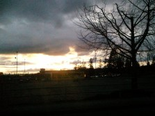 Yellow sunset under grey clouds