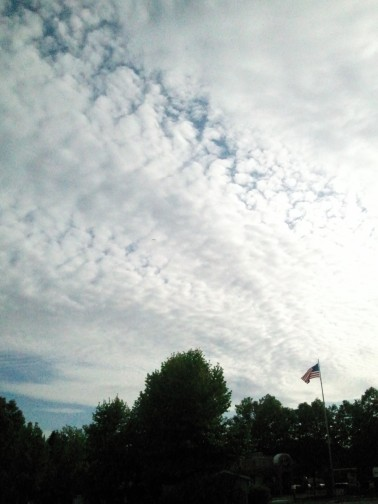 Clouds and flag