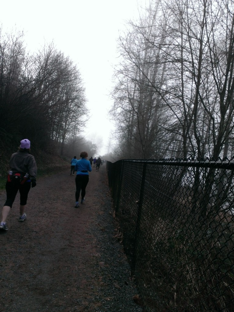 Walking fast, with some little jogging here and there, on a foggy trail