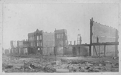 Downtown Seattle after the Great Fire (First Avenue between Columbia Street & the Skid Road). Image from the Museum of History & Industry